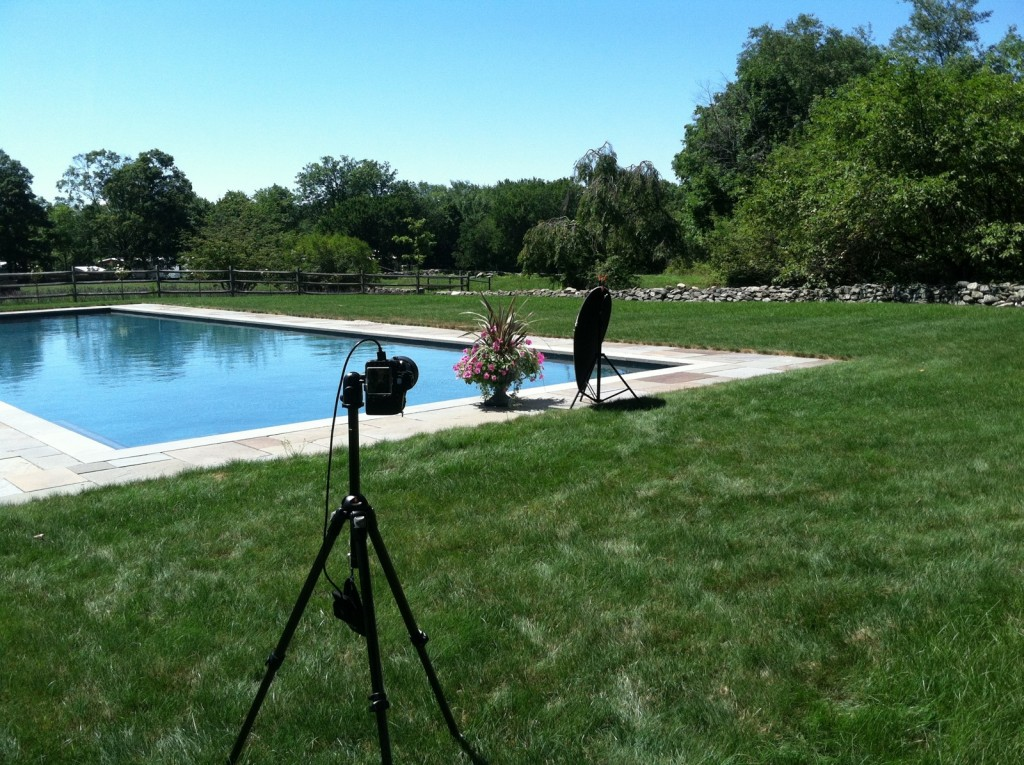 1. annual collections photography_poolside with reflector and tripod