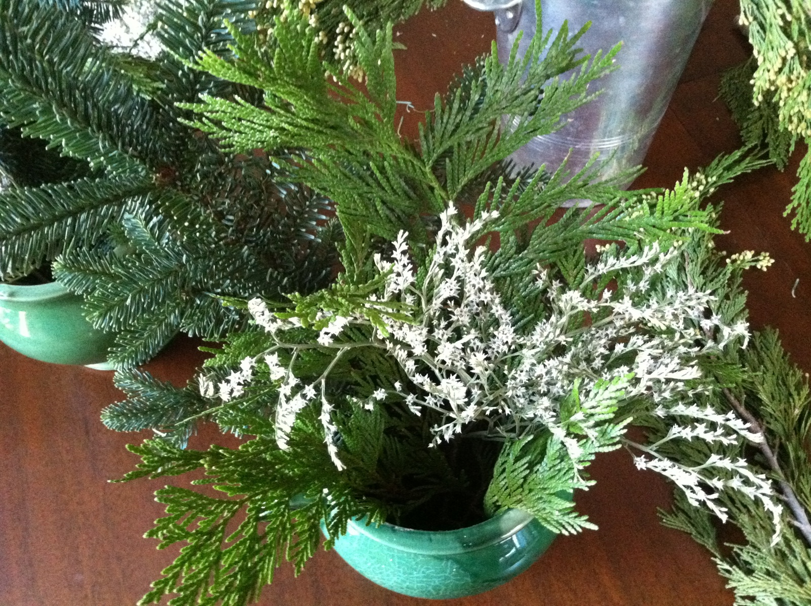 3-the-arrangements-are-coming-along-the-dried-white-statice-in-our-box-of-decorating-greens-resembles-a-s